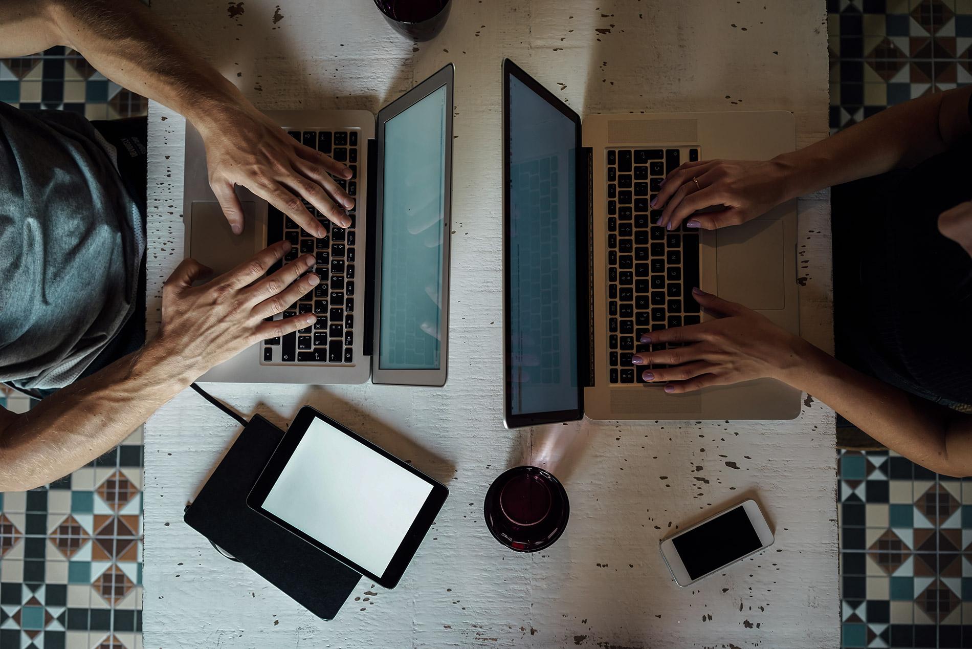 Man-Woman-Working-on-Computer_AdobeStock_102530896